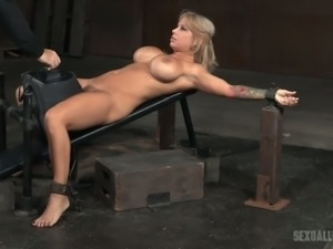 Juicy and busty blonde cougar oiled up and restrained for BDSM oral sex