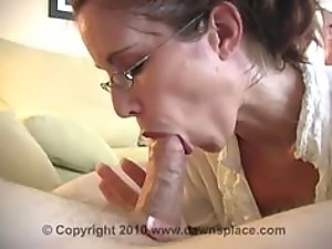 Glassed Brunette MILF Gives Blowjob and Swallows Cum In an Amateur Vid