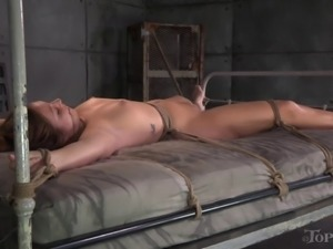 Delicious babe is tied up to a bed and attacked with the suction toys