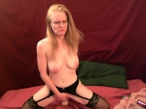 Wondrous bosomy auburn MILF in red stuff used a dildo to fuck herself