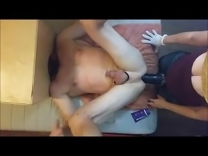 Strapon cowgirl - mans head in box - big strapon in his ass.