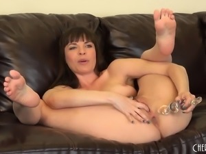 Dana DeArmond spreads her luscious legs and drills her tight anal hole