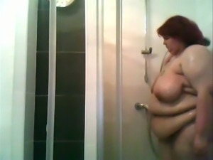 Hidden cam caught super chubby whore exposing her ugly belly in shower