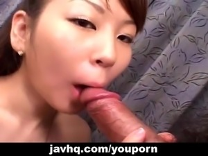 Asian babe sucking on a very rigid fat dick
