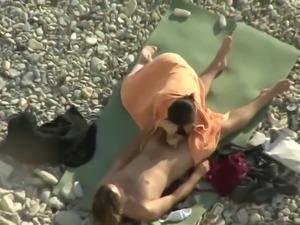 My friend peeks on amateur couple fucking super hot on the beach