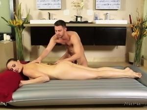 horny masseur pleasuring a brunette milf