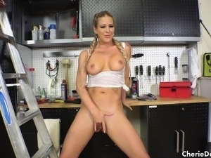 Pigtailed blonde nympho with big tits fucks her holes with some tools