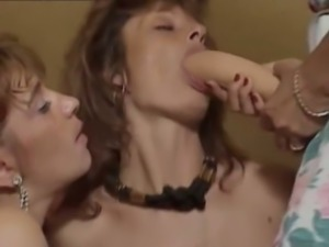 Two lean white chicks training cock sucking on a big dildo