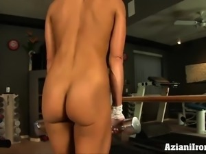 Abby shows off her sexy hard body in a gym while working out