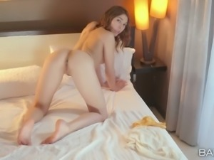 Sexy babe Sabrina strips to demonstrate her beautiful pussy