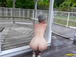 Woman with short hair shagged hard during an outdoor erotic game