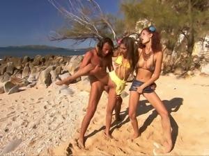 Sahara and Leanna treat a fellow to a threesome on a beach