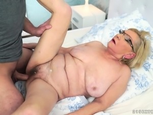 Blonde granny receives a young throbbing tool in her cunt
