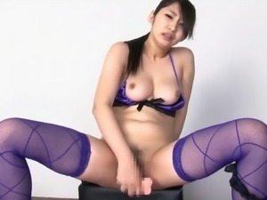 Marina Shinna riding a sex machine while wearing blue stockings