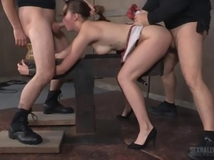 Sweet slave girl ravished by a couple of boners during a BDSM game