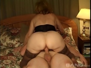 Mature woman with a hairy pussy enjoying a hardcore threesome