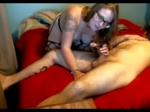 Tattoed MILF in glasses makes a blowjob and a homemade video