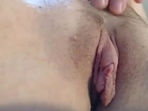Closeup of hairy big pussy lips and clit