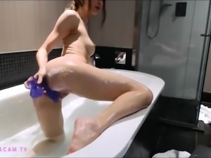 Natural beauty showers and dildos her pussy