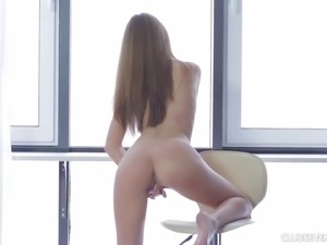Tini is completely naked and ready to reach an orgasm as we watch
