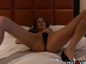 Skinny brunette fingering herself in bed