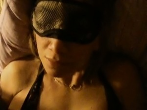 Wearing sleeping mask brunette MILF with big tits masturbated her slit