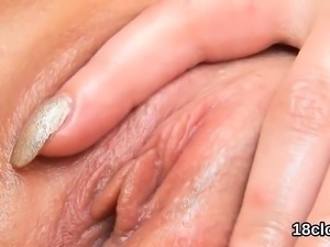 Sweet cutie is gaping yummy pussy in close-up and coming