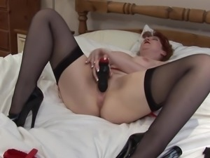 Big tits cowgirl inserting massive toy in her pussy