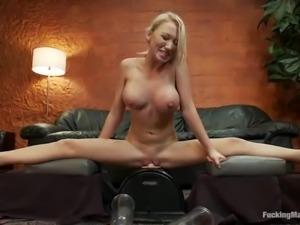 Blondie with huge melons is going to fuck a machine