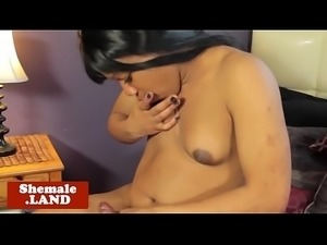 Ebony shemale stroking her cock