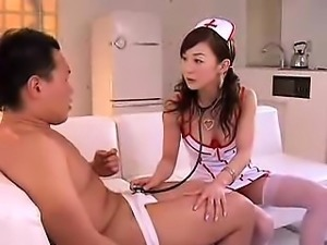 Sensual Oriental nurse in sexy lingerie sucks and rides a t
