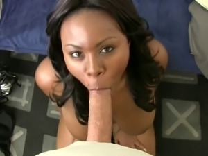 Curvy ebony slut slides on black cock on the sofa