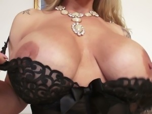Magnificent and busty blonde cougar in black lingerie wants to fuck