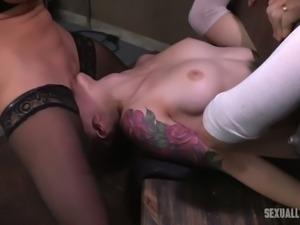 Horny BDSM milf licks pussy of a white restrained girl and bones her with...