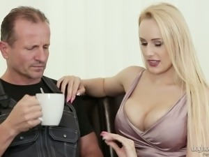 Fantastic pale skin blonde bimbo eats dick and fucks on the couch