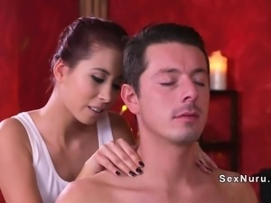 Busty Asian masseuse giving orgasmic handjob