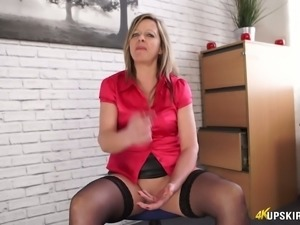Curvy and sexy blonde milf at work flashes her booty upskirt on cam