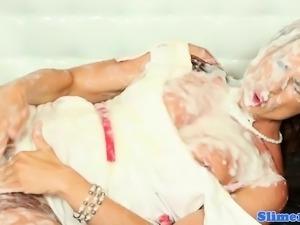Redhead bukkake babe bathes in cum