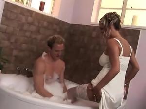 Horny blonde with big tits enjoys big cock in bathroom