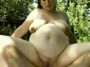 Pregnant babe banged in doggy on bench outdoors