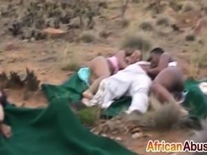 Three African sluts get two stiff cocks outdoors