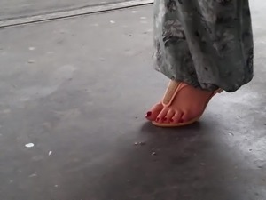 Turkish woman with hot long toenails in red