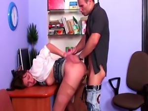 Horny stud puts stepsis on a work table and fucks her pussy and tight