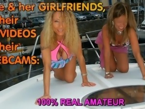 Lesbians in car, on boat in marina with strapon