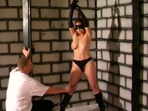 Chubby slut gets tied to the ceiling by chubby dude