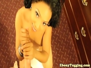 Thick ebony babe tugging hard cock