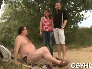 Curious young playgirl gives a oral to an old crazy chap
