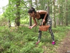 Stacked lesbian babe Rachel Evans is having some naughty fun in the woods
