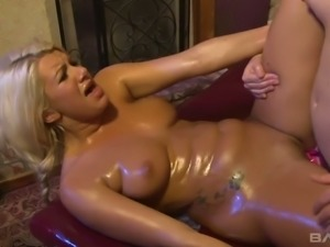 Oiled big breasted blondie enjoys massage and anal masturbation