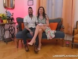 Lara is a woman with gloves who needs a tattooed man's penis